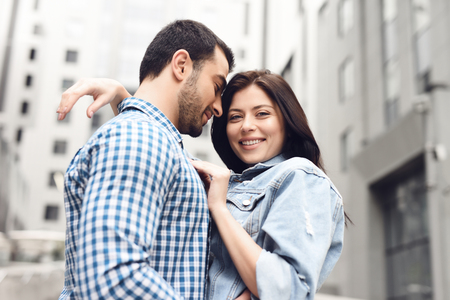 Happy couple hugging in alley. Girl looking at camera. Stock Photo - 101731466