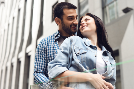 Couple in love near glass barrage. Happy look. Romantic concept. Stock Photo