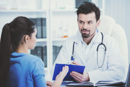 Doctor and patient are discussing something. Healthcare and medicine concept. Stockfoto
