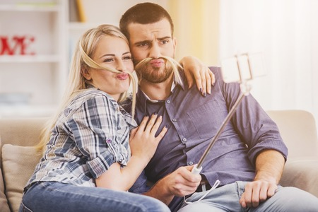 Happy Young Couple Taking Selfie Photo at Home. Romantic Relationship between People Concept. Date on Saint Valentines Day. Idyll of Young Couple. Love Concepts. Romantic Date Concept.