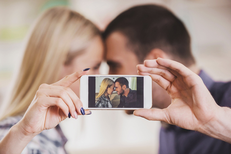 Close up. Young Couple Taking Selfie Photo at Home. Romantic Relationship between People Concept. Date on Saint Valentines Day. Idyll of Young Couple. Love Concepts. Romantic Date Concept.