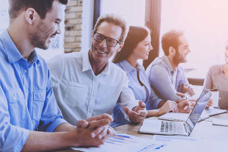 Business People in Smart Casual Wear Discussing Affairs. Business People Meeting Conference Discussion Corporate Concept. Successful Interesting Businessmen Discussing Important Documents. Banque d'images