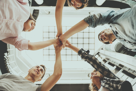 Students Standing in Circle and Holding Hands. Teamwork. Funny Students Years. Group of Young Happy People Have Fun. Education Teamwork and Teambuilding Concept. Funny Students Years. Stock Photo
