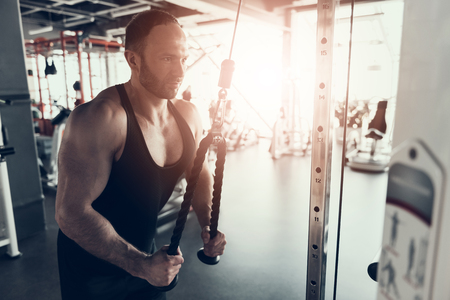 Bearded Young Man with Training Apparatus in Gym. Man with Athletic Body. Healthy Lifestyle and Sport Concepts. Young Man in Training Club. Active Indoor Training. Sport Equipment.