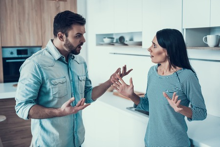 Young Couple Have Disagreement in Kitchen at Home. Quarrel in Young Family. Sad Woman. Divorce Concept. Upset Husband. Relationship between People Concept. Conversation in Kitchen.