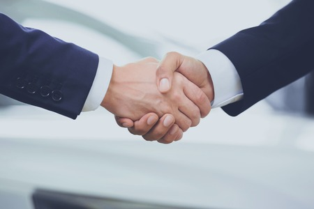 Business Partnership Giving Handshake. Business Concept