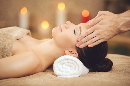 Smiling Woman Getting Massage in Health Spa. Spa Concept.