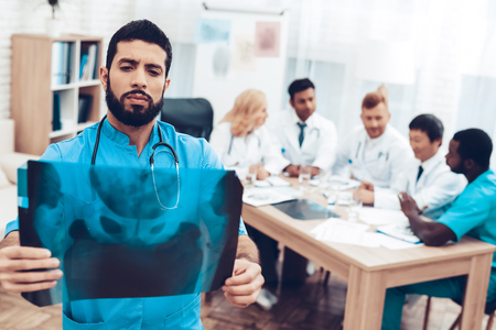 Doctors Meeting. Diagnostic Discussion. Multinational Medicals. Professional Consultation. Patients Test. Latine Specialist With X-ray Results. Clinician Team Group. Physician Assistants.