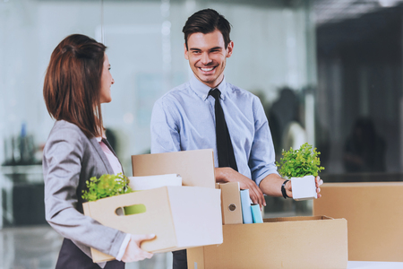 Workers with Carton Boxes. Smiling in Office. Packed Stuff for Moving. Business Concept. People in Formal Clother. Working Process. Documents in New Office. Documents and Personal Things. Standard-Bild - 105990652