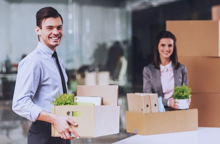 Workers with Carton Boxes. Smiling in Office. Packed Stuff for Moving. Business Concept. People in Formal Clother. Working Process. Documents in New Office. Attractive Managers. Personal Things. Standard-Bild - 106062689