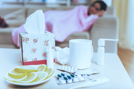 Pills Tea Lemon and Napkins. Sadness Woman. Top View. Medications in Closeup. Cup of Tea. Young Brunette Disease. Virus and Sad. Treatment at Home. Sikness Symptom. Infection and Healthcare.