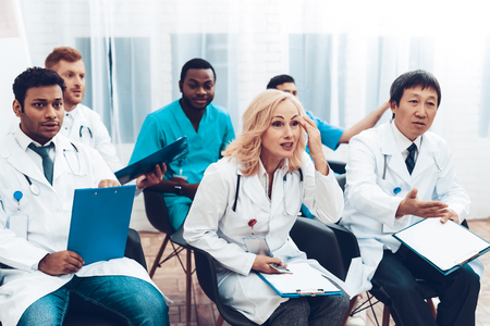 Multinational Doctors Consultation. Office Meeting. Bored Specialists. Hospital Discussion. Medical Teamwork Connection. Diagnostic Question. Clinician Team Group. Professional Team Arguing.