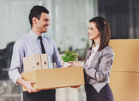 Worker Helping Collegue. Carry Box in Office. Young Businessman and Business Woman. Packed Stuff for Moving. Business Concept. People in Formal Clother. Working Process. Attractive Managers. Standard-Bild - 106089479