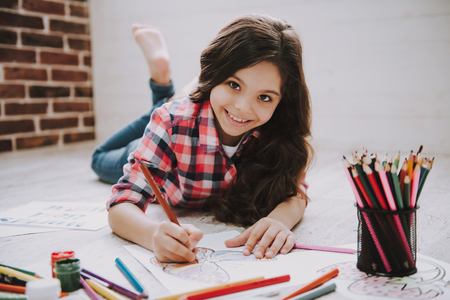 Cute Girl Drawing Pictures with Color Pencils. Girl Drawing Picture with Color Pen, Education Concept. Caucasian Wearing Casual Clothes Rest at White Wooden Floor. Creative Kids Concept