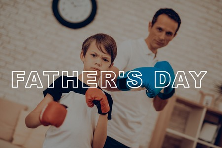 Father And Son Boxing Training. Sports Family. Healthy Lifestyle. Active Holiday. Gym Clothes. Working Out At Home. Fight Gloves. Punch Training. Repeating Exercises. Camera Staring. Reklamní fotografie