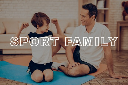 Father And Son Are Doing Gym. Sport Family. Healthy Lifestyle. Active Holiday. Exercises Clothes. Getting Better. Working Out At Home. Gym Carpet. Repeating Practice. Biceps Measuring.