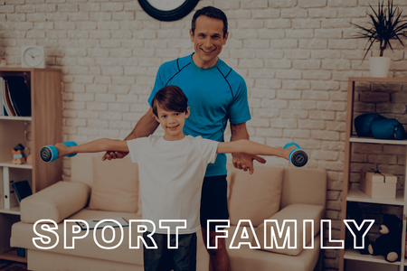 Man With Son Are Doing Exercises With Dumpbells. Healthy Lifestyle. Active Holiday. Sports Clothes. Working Out At Home. Gym Carpet. Repeat Practice. Body Exercises. Family Training Concept.