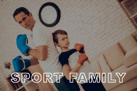 Father And Son Boxing Training. Sports Family. Healthy Lifestyle. Active Holiday. Gym Clothes. Working Out At Home. Fight Gloves. Punch Training. Repeating Exercises. Back To Back.