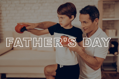 Father And Son Boxing Training. Sports Family. Healthy Lifestyle. Active Holiday. Gym Clothes. Working Out At Home. Kid With Boxing Gloves. Punch Training. Repeat Exercises. Right Handed Hook.