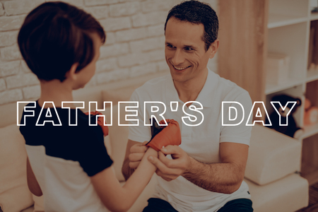 Father Is Winding A Bandage On A Sons Hands. Sports Family. Healthy Lifestyle. Active Holiday. Gym Clothes. Working Out At Home. Kid With Boxing Gloves. Training Day Concept. Box Equipment. Reklamní fotografie