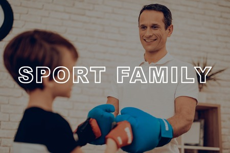 Father And Son Boxing Training. Sports Family. Healthy Lifestyle. Active Holiday. Gym Clothes. Working Out At Home. Fight Gloves. Punch Training. Repeating Exercises. Face To Face. Reklamní fotografie