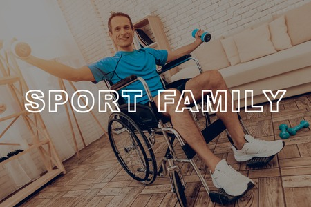 Man In Sport Clothes Work With Dumpbells In A Wheelchair. Healthy Lifestyle. Active Holiday. Sports Clothes. Getting Better. Working Out At Home. Gym Carpet. Repeat Practice. Body Exercises. Reklamní fotografie