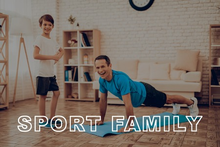 Smiling Father Is Doing Push Ups. Sport Family. Healthy Lifestyle. Active Holiday. Exercises Clothes. Getting Better. Working Out At Home. Gym Carpet. Repeat Practice. Holiday Leisure.