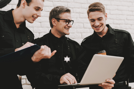 Officer Instructs Subordinates In Police Station. Working On A Laptop. Crime Fighters. National Duty. Professional Consulting. Detective Uniform. Citizens Protection. Specialists Studying.