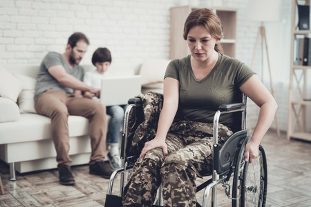 Disabled Soldier In Wheelchair. Suffer From Pain. Meeting After War. Son And Husband Background. Camouflage Uniform. Family Concept. Paralyzed Soldier. Home Leisure. Return From Army. Banque d'images - 107803677