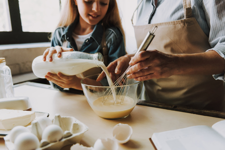 Grandma and Granddaughter Baking Kitchen at Home. Making the Dough. Grandma and Granddaughter Cooking Food. Healthy Lifestyle. Cooking At Home. Family Concept. Making Biscuit