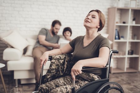 Disabled Soldier Woman In Wheelchair Concept. Meeting After War. Son And Husband Background. Camouflage Uniform. Family Background. Paralyzed Soldier. Home Leisure. Return From Army. Zdjęcie Seryjne