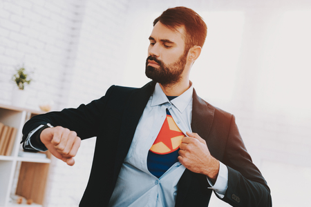 Man In Suit Hides Superhero Side. Time For Action. Double Life. Alter Ego. Ger Ready. Save The World. Strong And Powerful. Hidden Personality. Confidence And Bravery. Tattered Shirt. Stock Photo