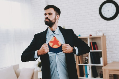 Man In Suit Hides Superhero Side. Time For Action. Double Life. Alter Ego. Ger Ready. Save The World. Strong And Powerful. Hidden Personality. Confidence And Bravery. Tattered Shirt. Banco de Imagens