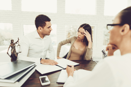 Upset Husband and Angry Wife in Office with Lawyer. Frustrated Husband. Problem in Relationship between People. Modern Law Office. Angry Young Wife. Marriage Problem. Young Advocate.