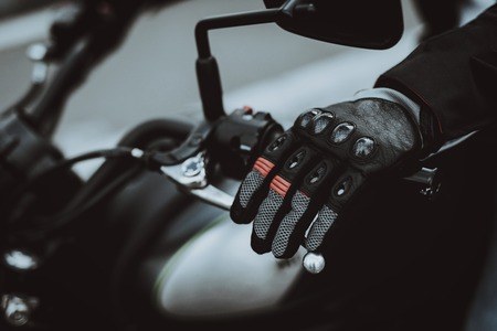 Hand Of A Biker Laying On Motorcycle Steering. Going For Ride. Speed Vehicle. Motorbike Concept. Tripping Together. Speed Choosing. Journey Start. Ready To Go. Power Button. Black Jacket. Stock Photo - 108580214