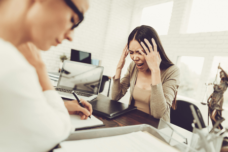 Young Upset Woman in Office with Lawyer in Glasses. Frustrated Woman. Problem in Relationship between People. Modern Law Office. Angry Young Woman. Marriage Problem. Young Advocate.