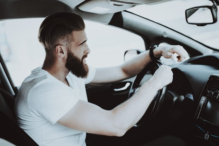 Caucasian Man In The Tesla Car. Front Seat Concept. Innovation Technology. New Generation Electro Hybrid Vehicle. Luxury Design. Futuristic Power. Hands On Display. Behind The Wheel. Stock Photo