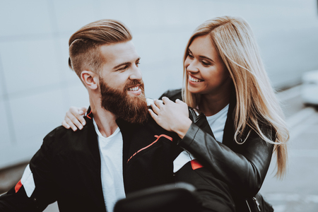 Man And Women Are Sitting On Motorcycle. Going For Ride. Fashion Riders. Confident Staring. Speed Vehicle. Biker With A Beard. Motorbike Concept. Classic Style. Ready To Drive. Tripping Together. Stock Photo - 108172258