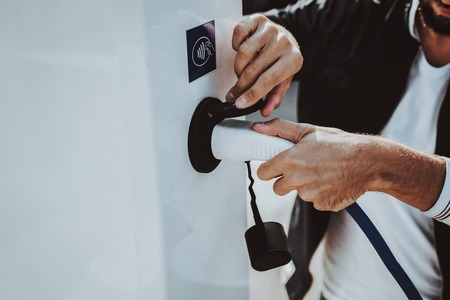 Car Cable Plug In A Socket. Automobile Charging Station Concept. Innovation Technology. New Generation Electro Hybrid Vehicle Plugin. Ecology Charge Station. Futuristic Power. Stock Photo - 108580243