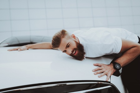 Cheerful Man Is Hanging The Hood Of  Car. Charge Station. Automobile Love Concept. Innovation Technology. New Generation Electro Hybrid Vehicle Plugin. Sweet Emotion. Futuristic Power. Stock Photo