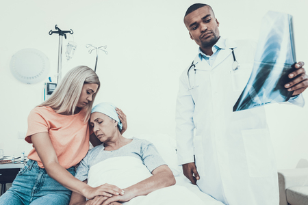 Woman with mother. Cancer Patient. Doctor looks X-ray. Disease doesnt recede. Upset Women. Doctor in Ward. Woman Undergoes Rehabilitation. After Treatment for Cancer. Woman on Bunk. Doctor in Clinic.