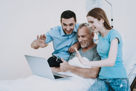Happy Family and Good Mood. Technology in Clinic. Technology and Family in Hospital with Old Man. Care about Old Man in Clinic. Disease in Clinic. Disease in Hospital. Young girl with Health Old Man.