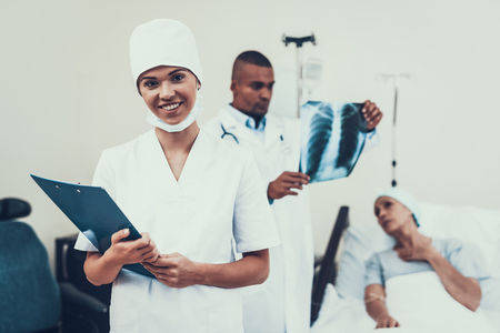 Nurse Posing. Background Patient. Nurses Notes. Woman Undergoes Rehabilitation. After Treatment for Cancer. Doctor in Clinic. Cancer Patient. Doctor looks at the X-ray. Woman on Bunk.