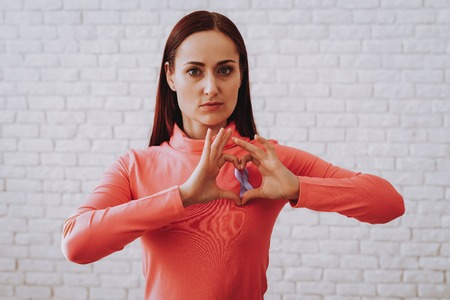 Woman in Pink Blouse Heart with Disease People who with Cancer. Strong Girl Sign for a Illness People. Woman and Studio. Style and Strong Style. Cute Woman Help People with Cancer. Studio and Girl.