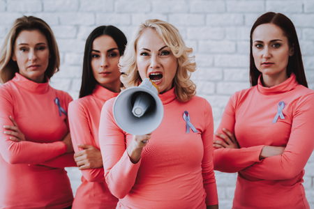 Beeauty Woman Screams in Horn. Support and Help People with Cancer. Lady and Friends. Health Friends Help People with Cancer. Screams on People. Strong Woman Pink Style Blouse. Health Model in Studio.