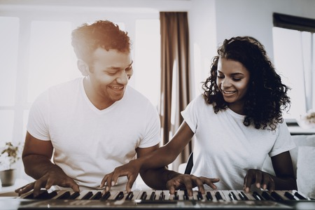 Afro American Couple Synthesizer Playing Concept. Happy Songwriter. Morning Leisure. Digital Format. Working Musician. Musical Hobby. Hands On Keyboard. Making Melody. Take A Rhytm.