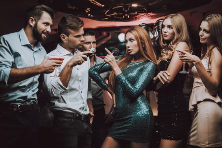 Karaoke Club. Celebration. Young People. Best Singer. Musical Battle. Singing Songs. Smiling Girl. Have Fun. Beautiful Girls. Friends at Karaoke Club. Party Maker. Girls Sing. Smile. Trendy Nightclub.