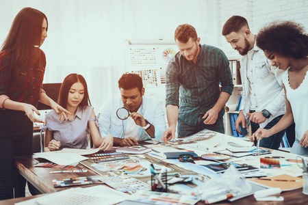 Generate Idea. Colors for Design. Different Races. Project. Landscape. Designers. Group. Teamwork. Designers. Cooperation. Brainstorming. Work. Table. Large Bright Office. Discuss. Samples. Schemes.
