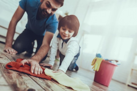 Happy Together. Cleanliness. Smile. Have Fun. Clean House Together. Family. Holidays.Two Boys. Father. Baby with Bright Hair. Smiling Kid. Spends Time. Home Time. Father Two Boys. Leisure Time. Man.