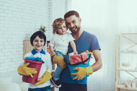 Smiling Kids. Cleanliness. Family. Holidays. Two Boys. Father. Baby with Bright Hair. Spends Time.Clean House Together. Happy Together. Leisure Time. Man. Smile. Home Time. Father Two Boys. Have Fun.